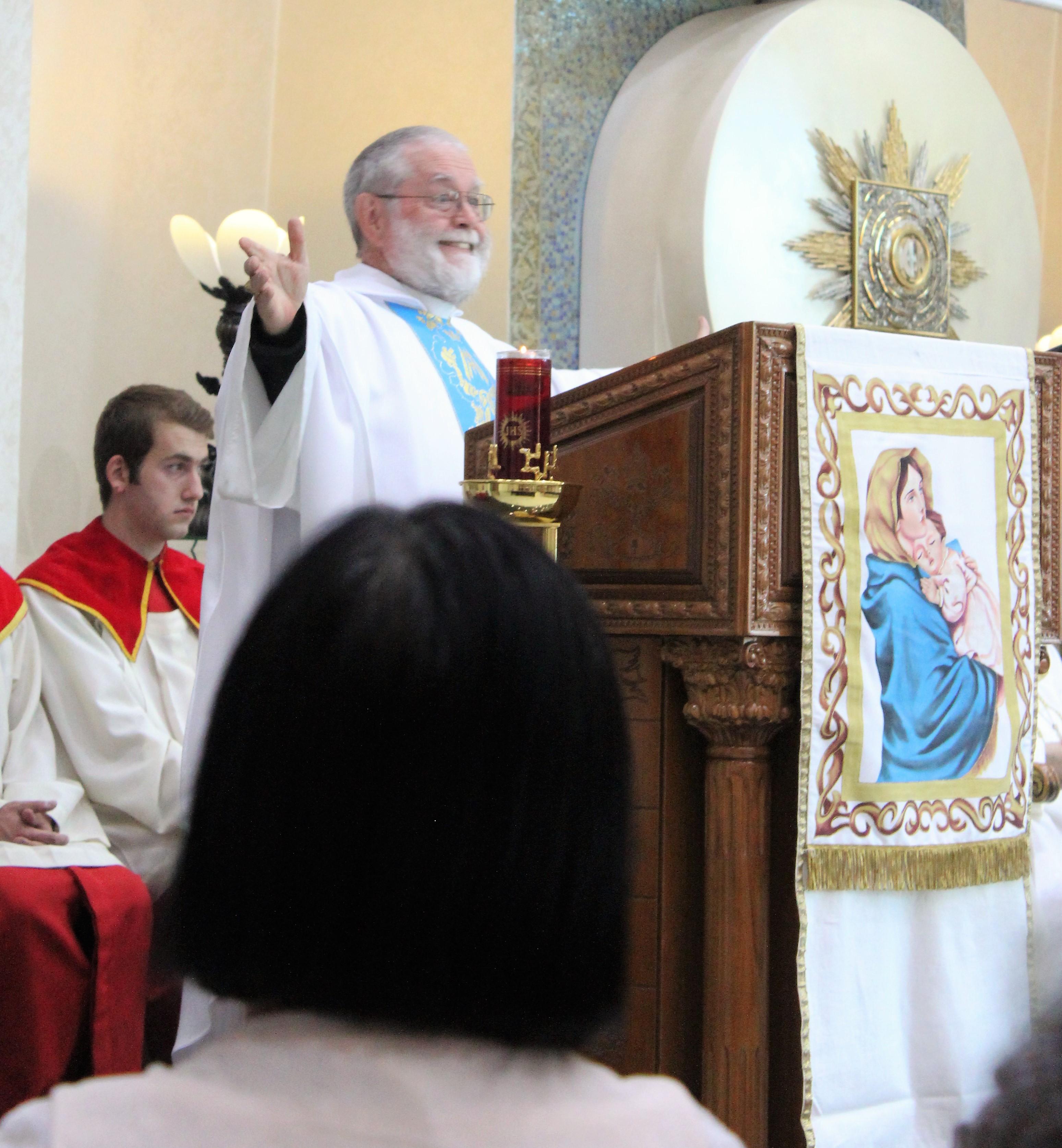 Fr. John embracing the people